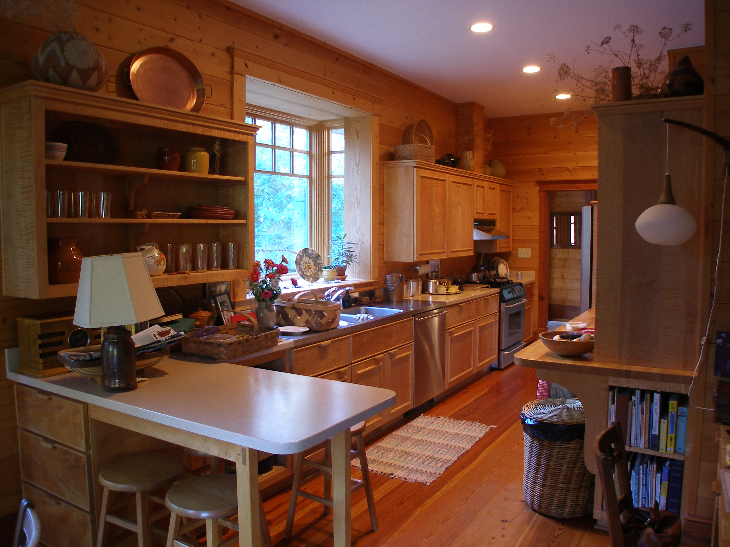 View of sink and window in galley kitchen.