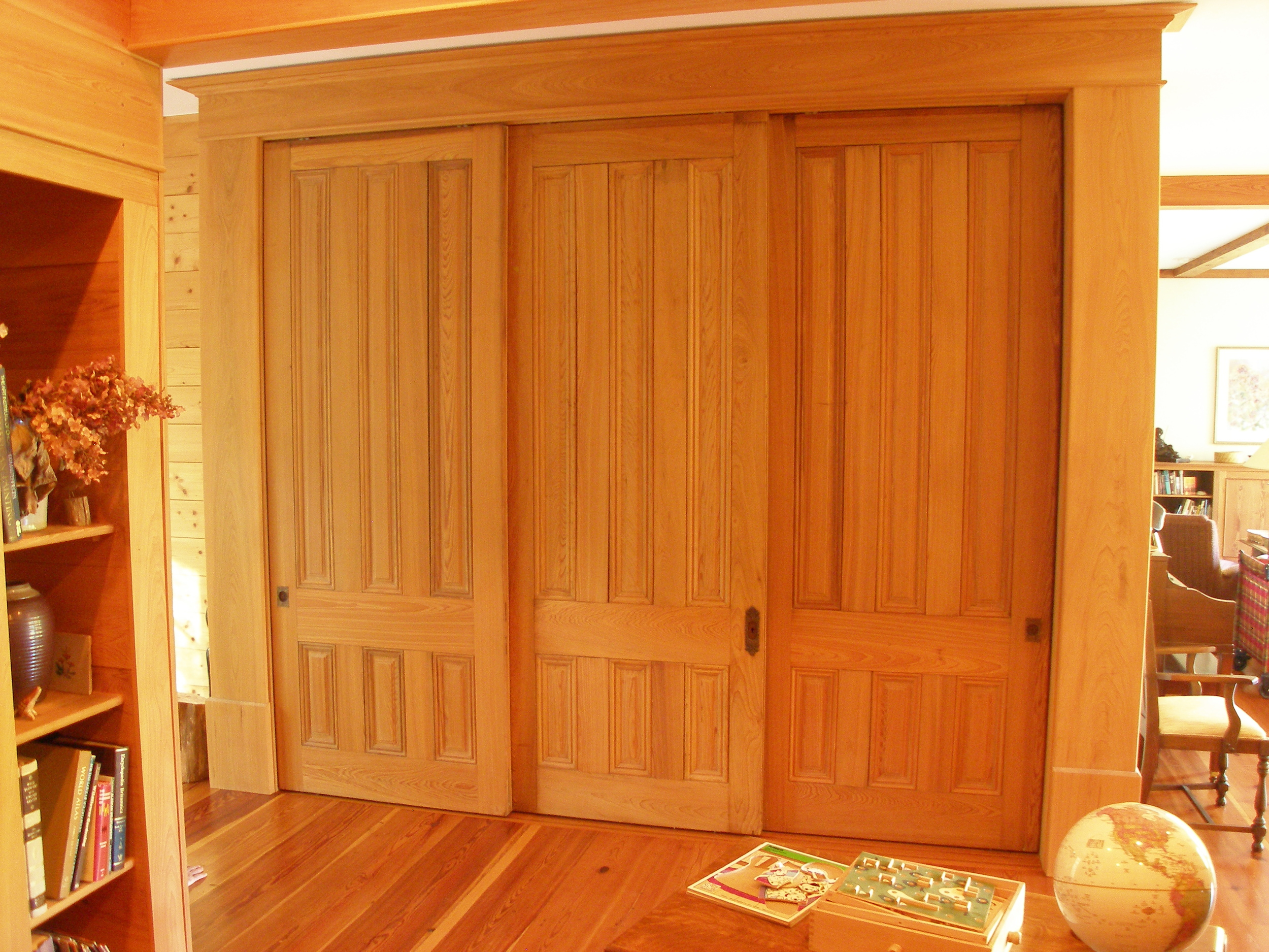 Sliding recycled, cypress doors in closed position.