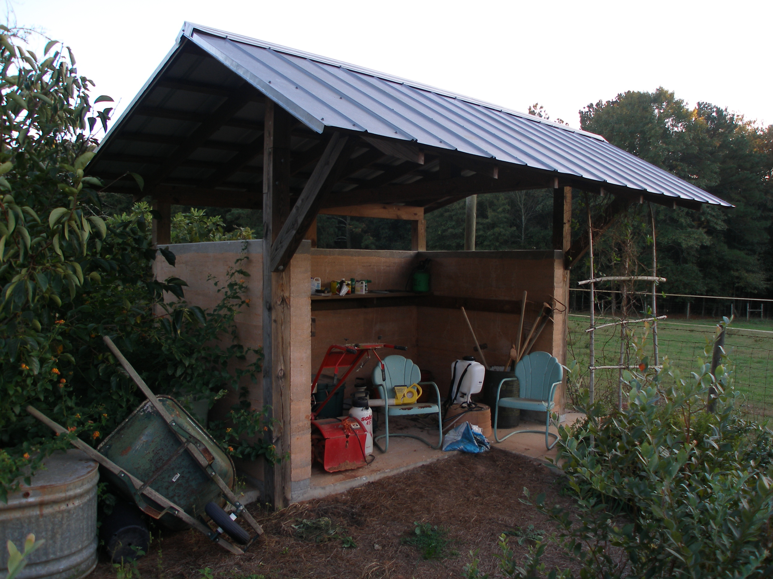Rammed earth garden shed.