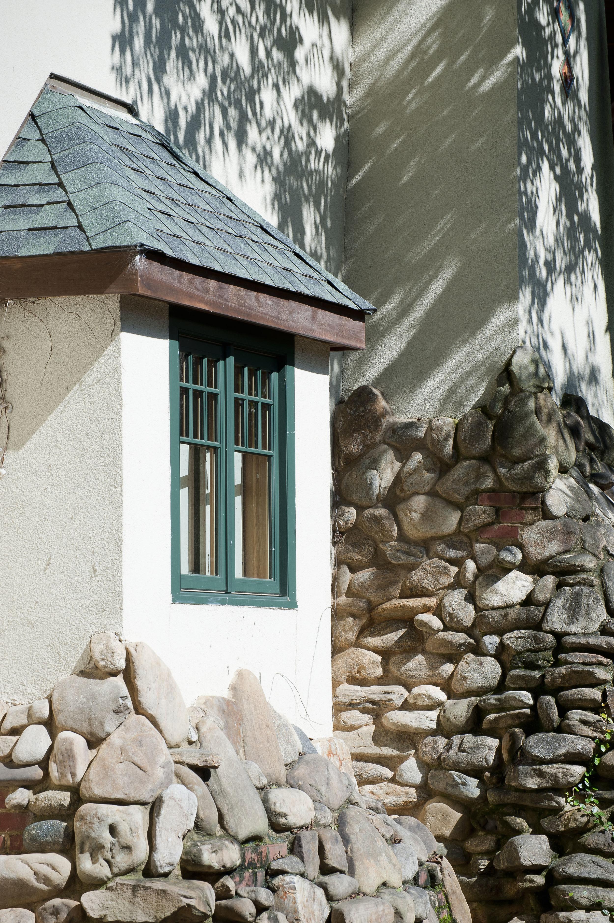 Greene and Greene inspired base for bay window and chimney.