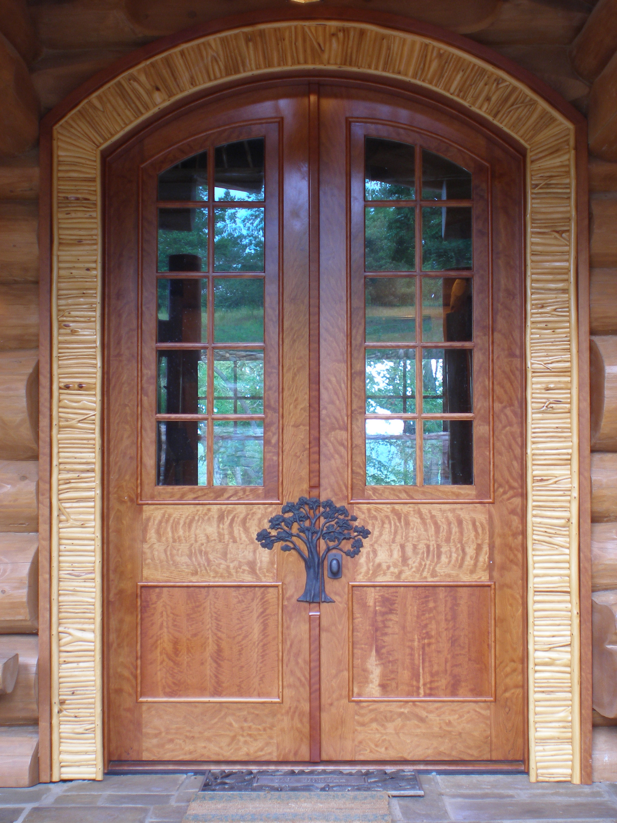 Front doors in curly cherry with applied twig casing.