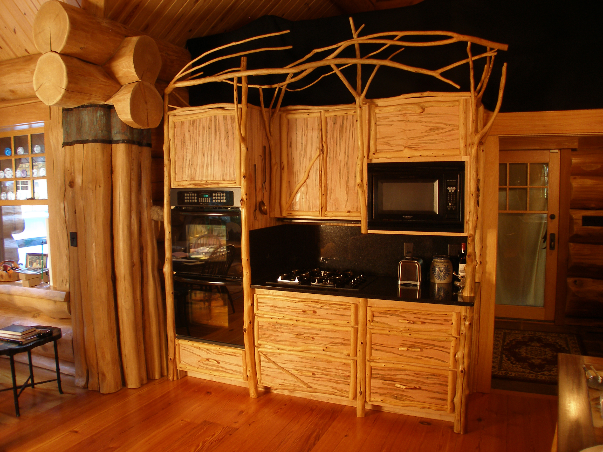 Wormy maple cabinets with organic eastern cedar crown.