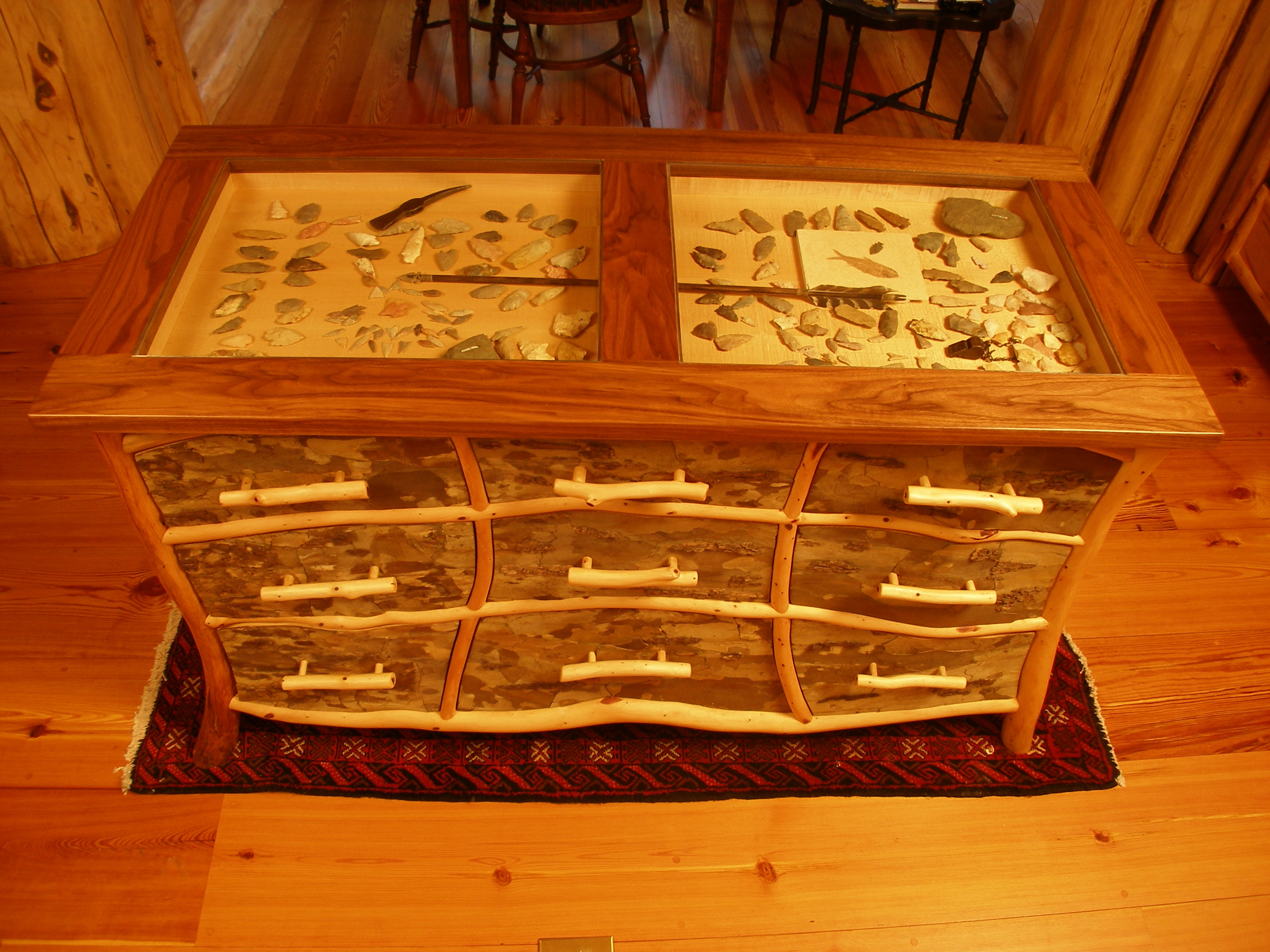 Kitchen island artifact display case-walnut top and eastern cedar frames with sycamore bark panels.