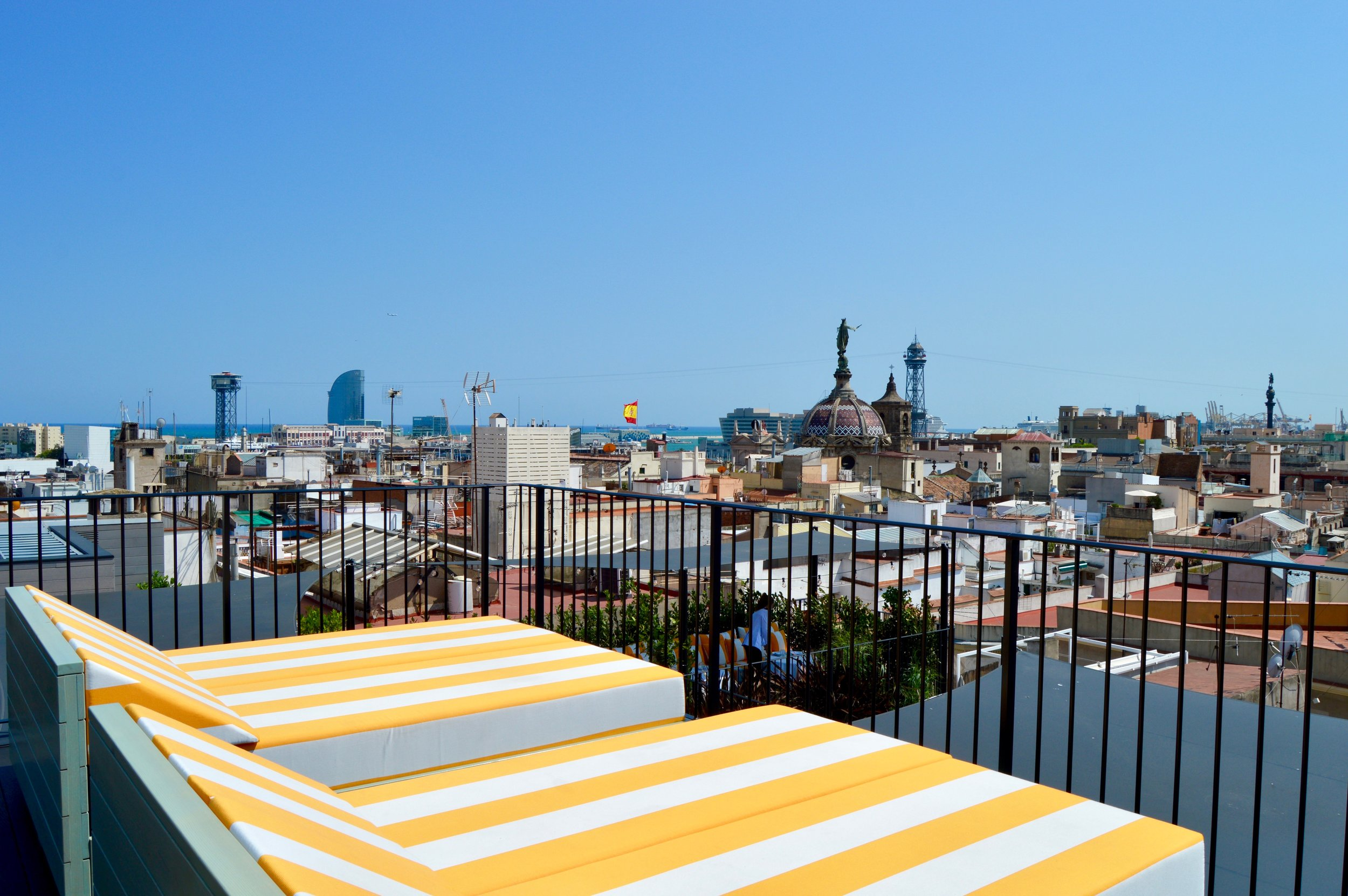 The Sun Deck's views to La Barceloneta, the cable car connecting Barcelona to  Montjuic , and the W Barcelona in the distance.