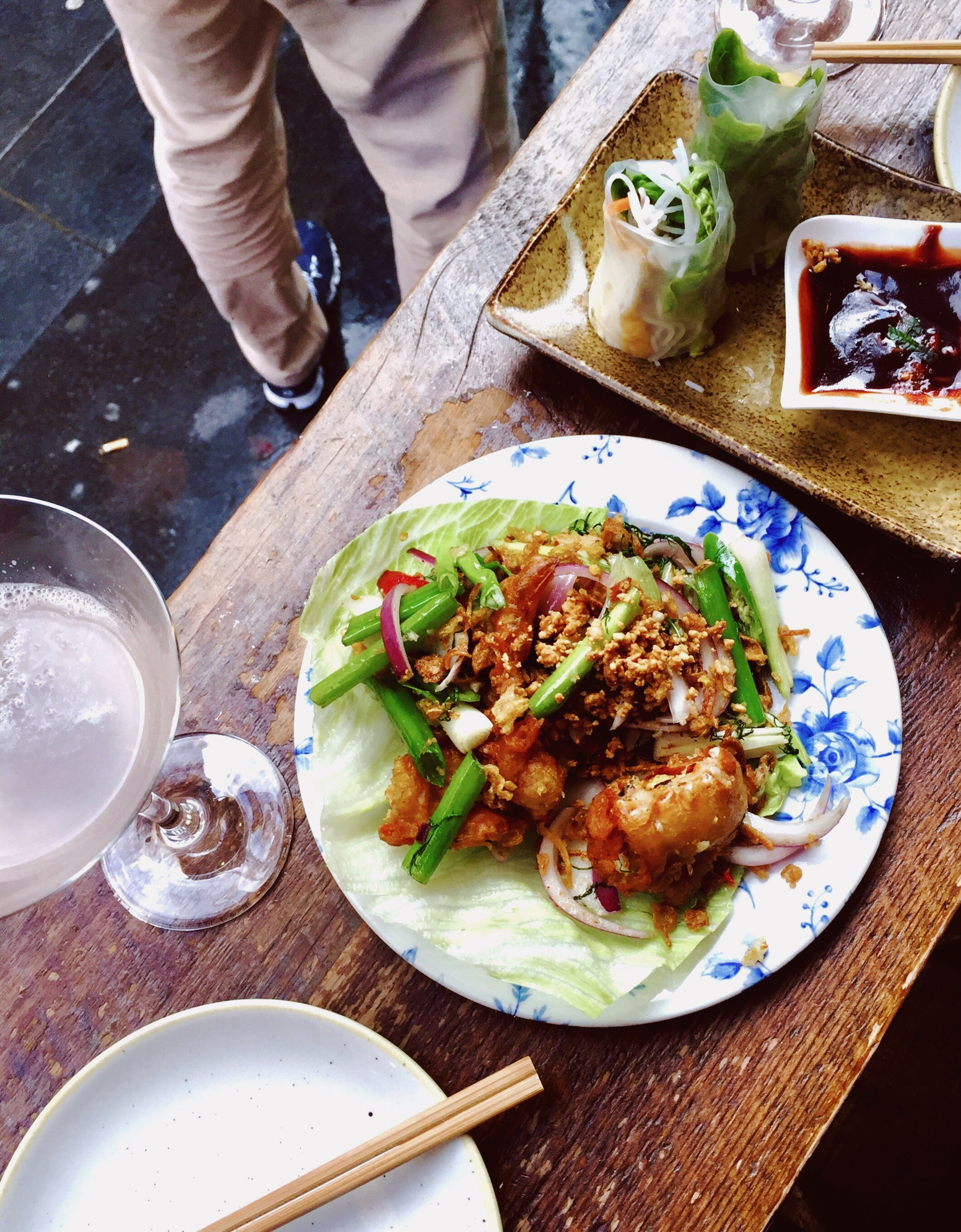 """My funny """"street"""" view as we ate at the window table . . . vegetarian summer rolls and spicy soft shell crab on the plates and lychee martini."""