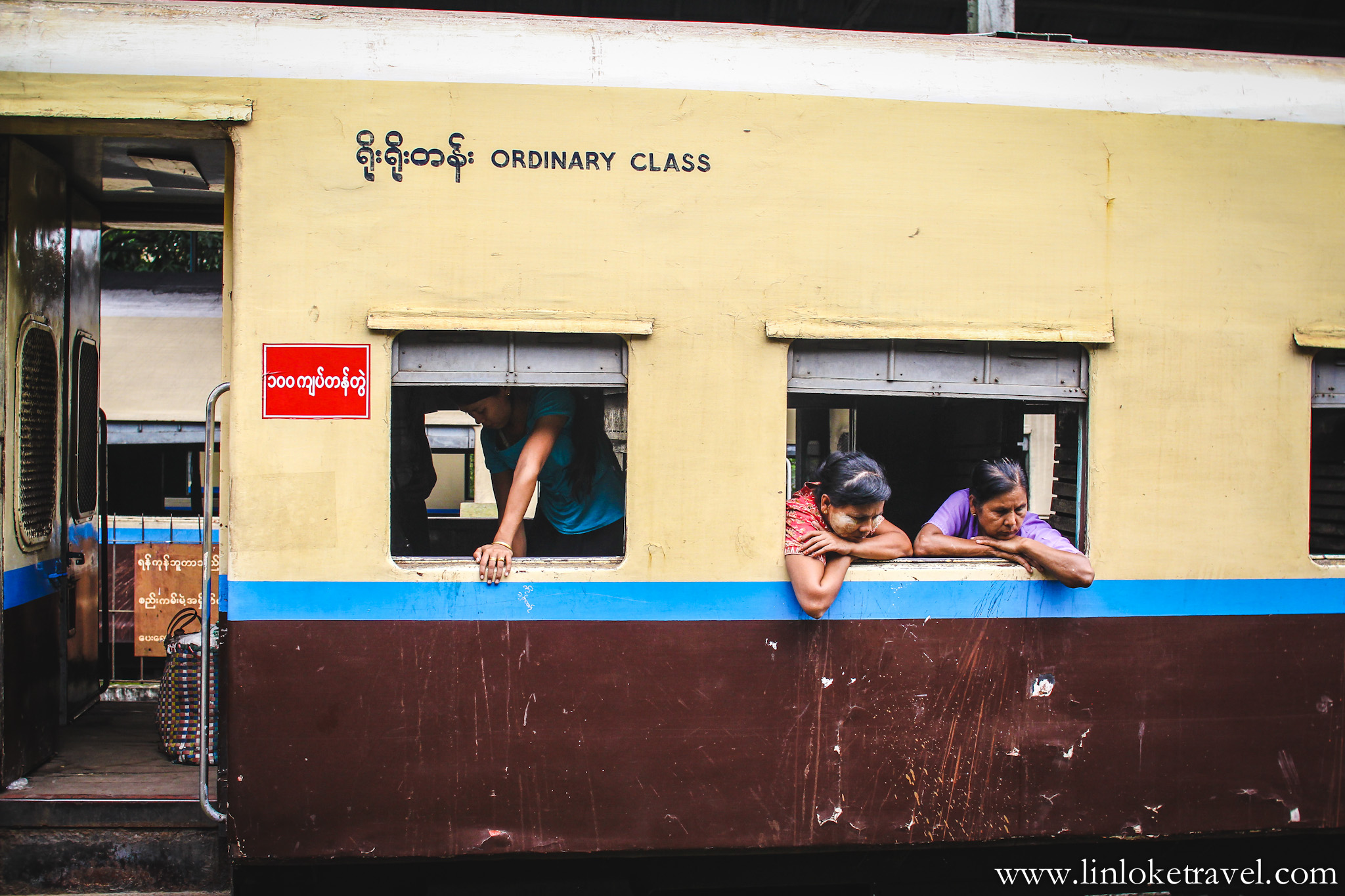 Non air-conditioned train departing from Yangon Central Railway Station
