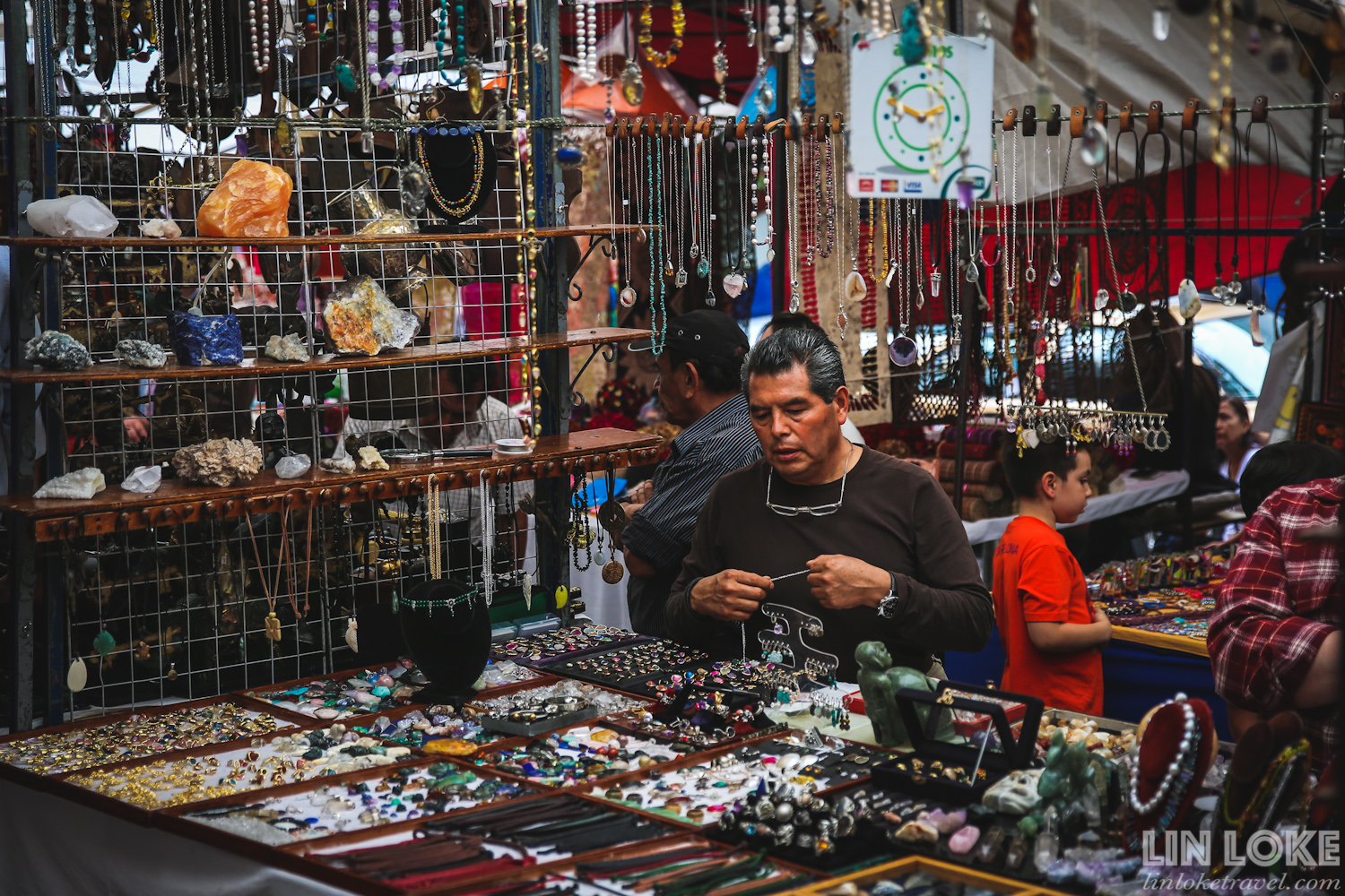 A man selling jewellery and gemstones at San Angel Bazaar