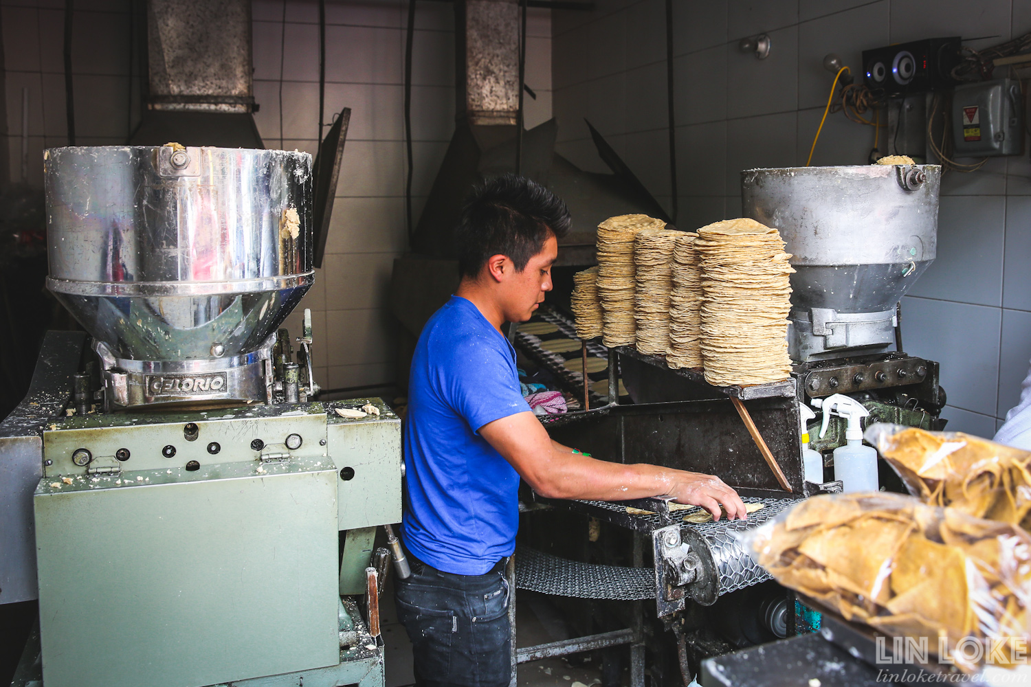Amongst the glamorous and edgy cocktail clubs in Condesa/ Roma area are also traditional family-run businesses. This picture shows a boy hand-making corn tortillas in a wholesale tortilla shop.