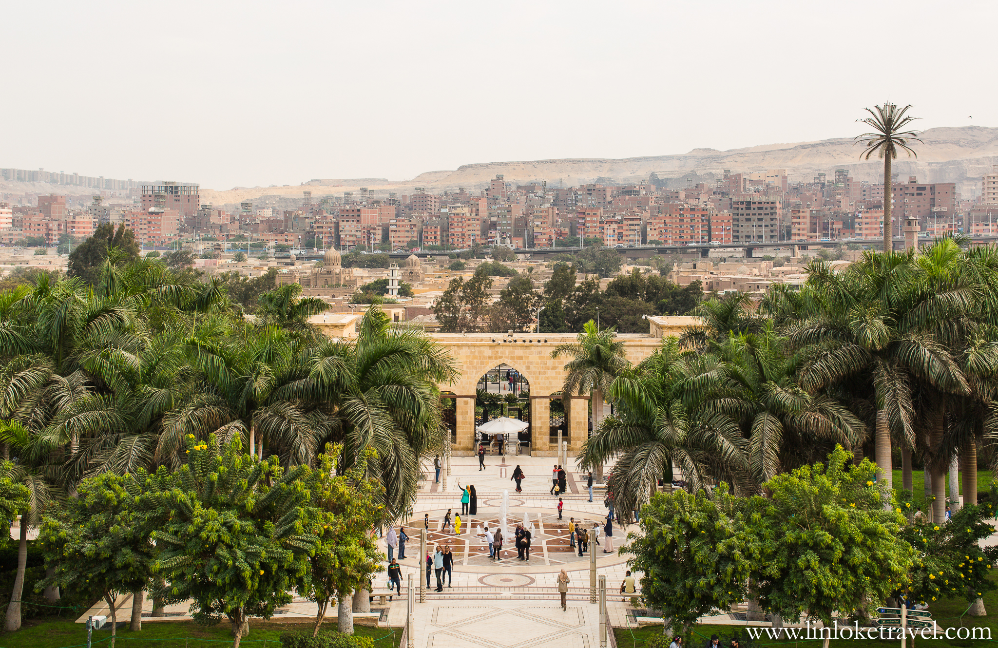The entrance to Al-Azhar Park delineates a polarising landscape between the park and Cairo city.