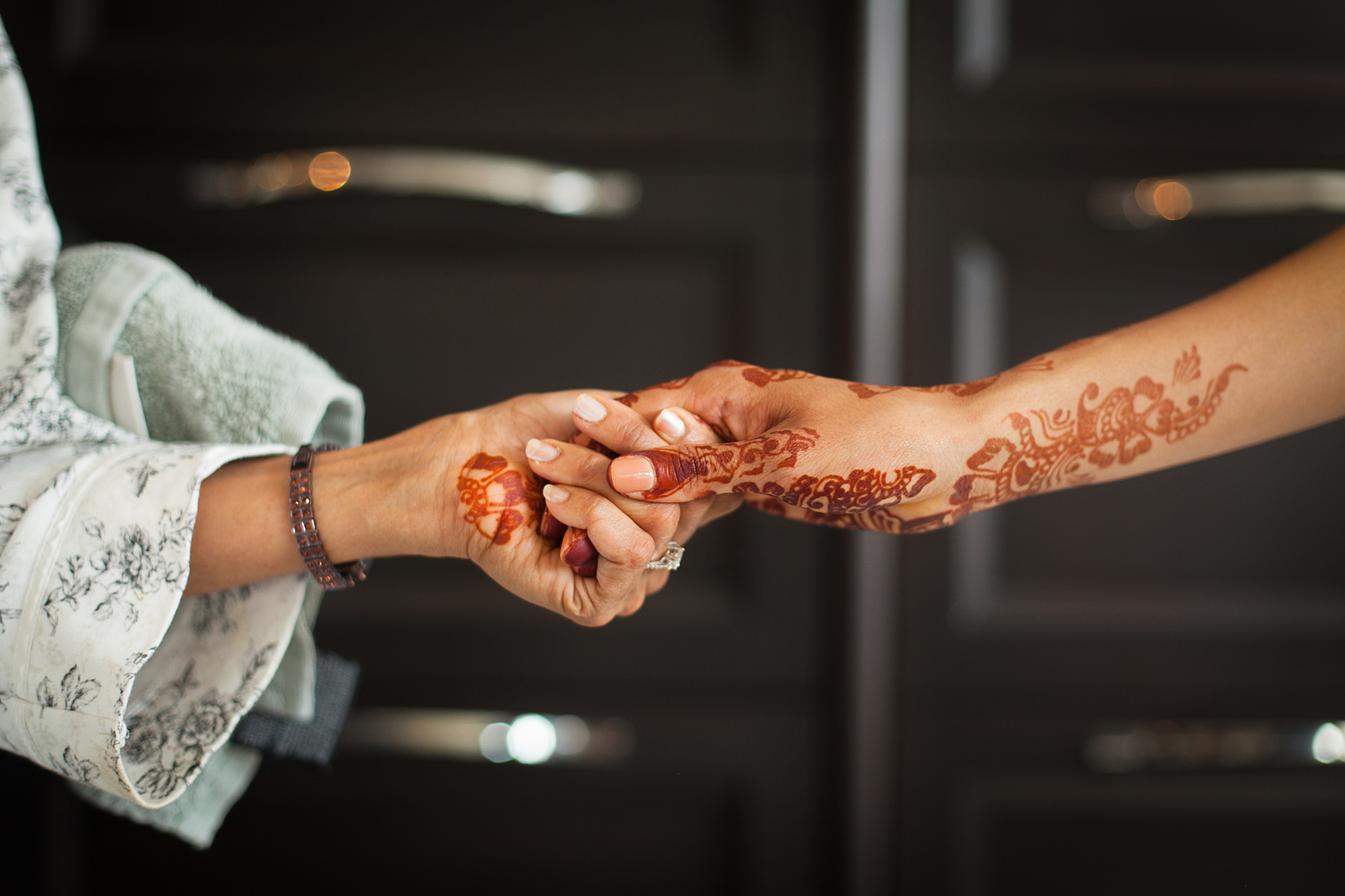Oriana Koren Weddings couple holding hands decorated with henna ink