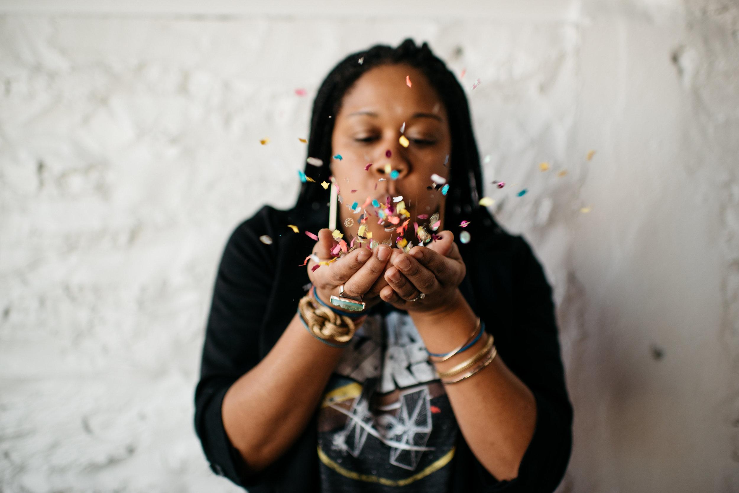 Adina Franconi blowing confetti