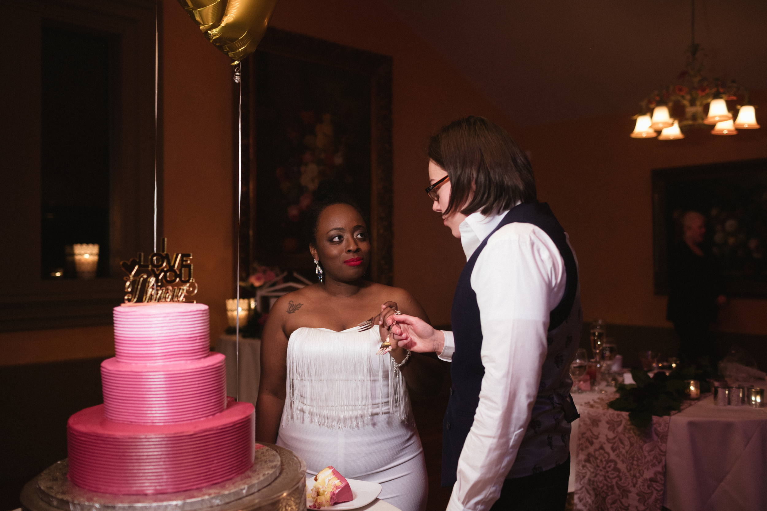 Ash Carr Wedding Photography New York couple having cake