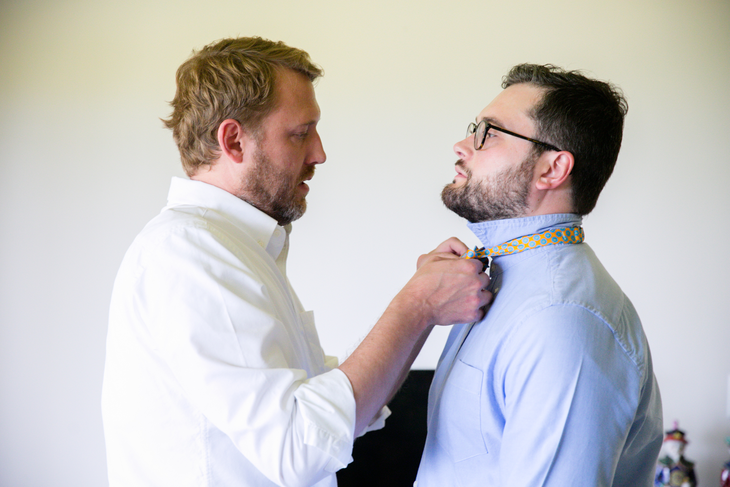 Lisa25 Wedding Photography groom tying fiancé's tie