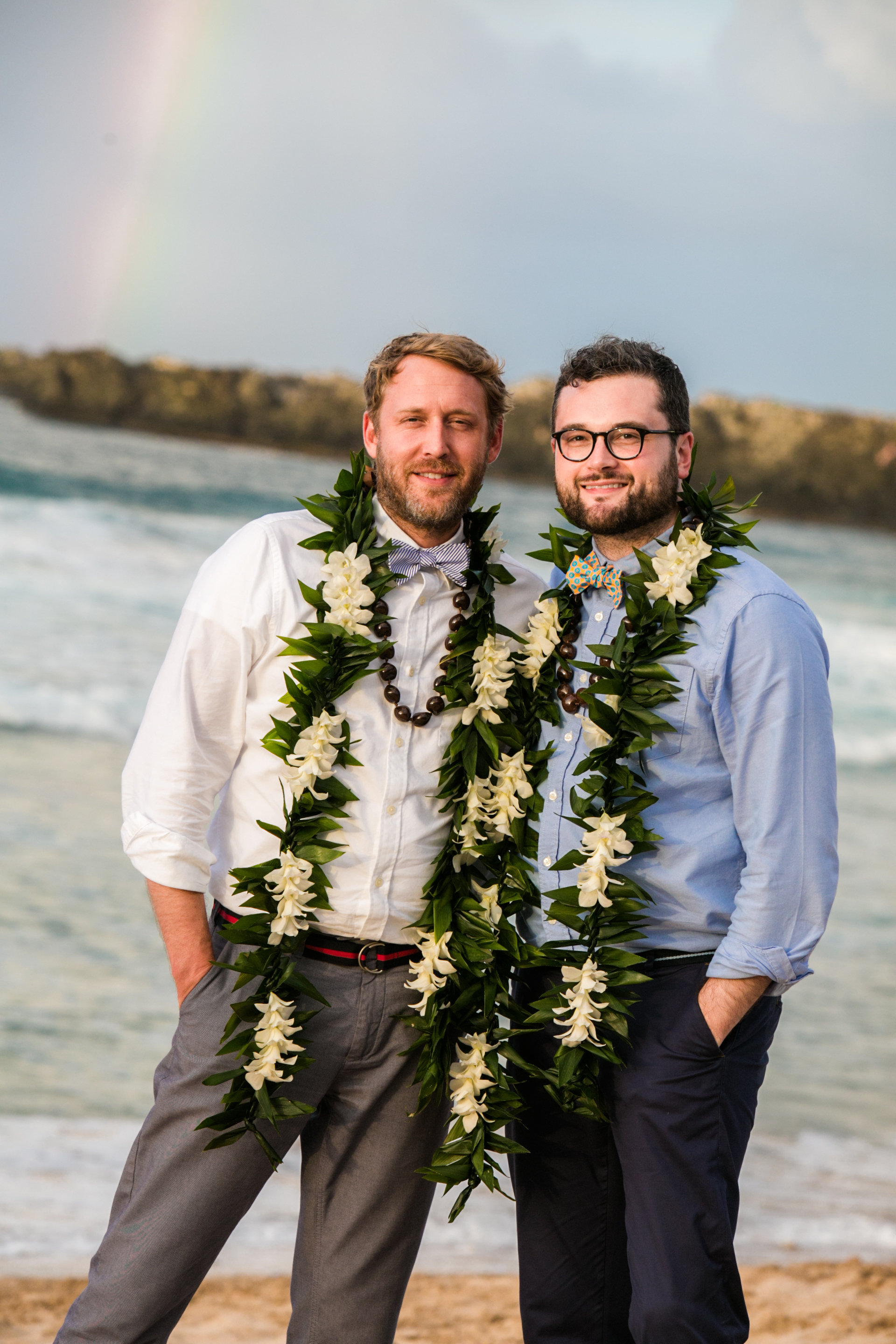 Lisa25 Wedding Photography couple by ocean with rainbow in background