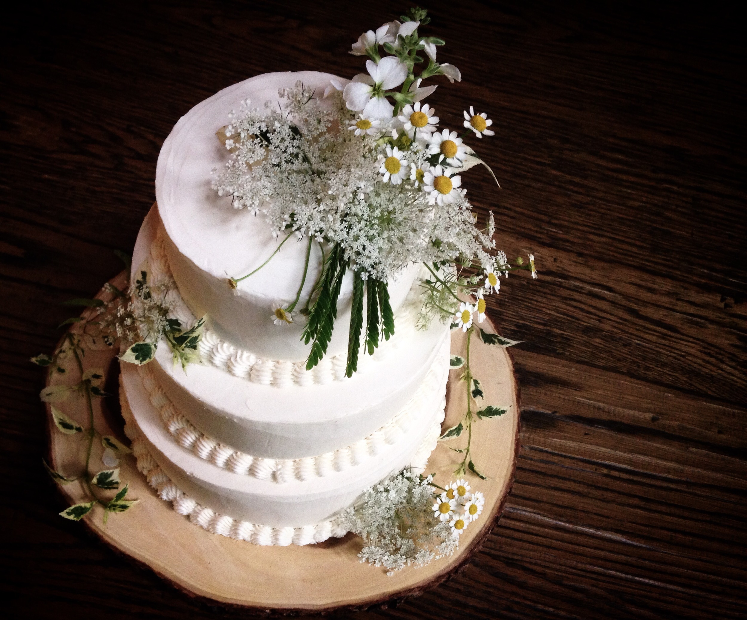 Cake adorned with flowers by molly reeder