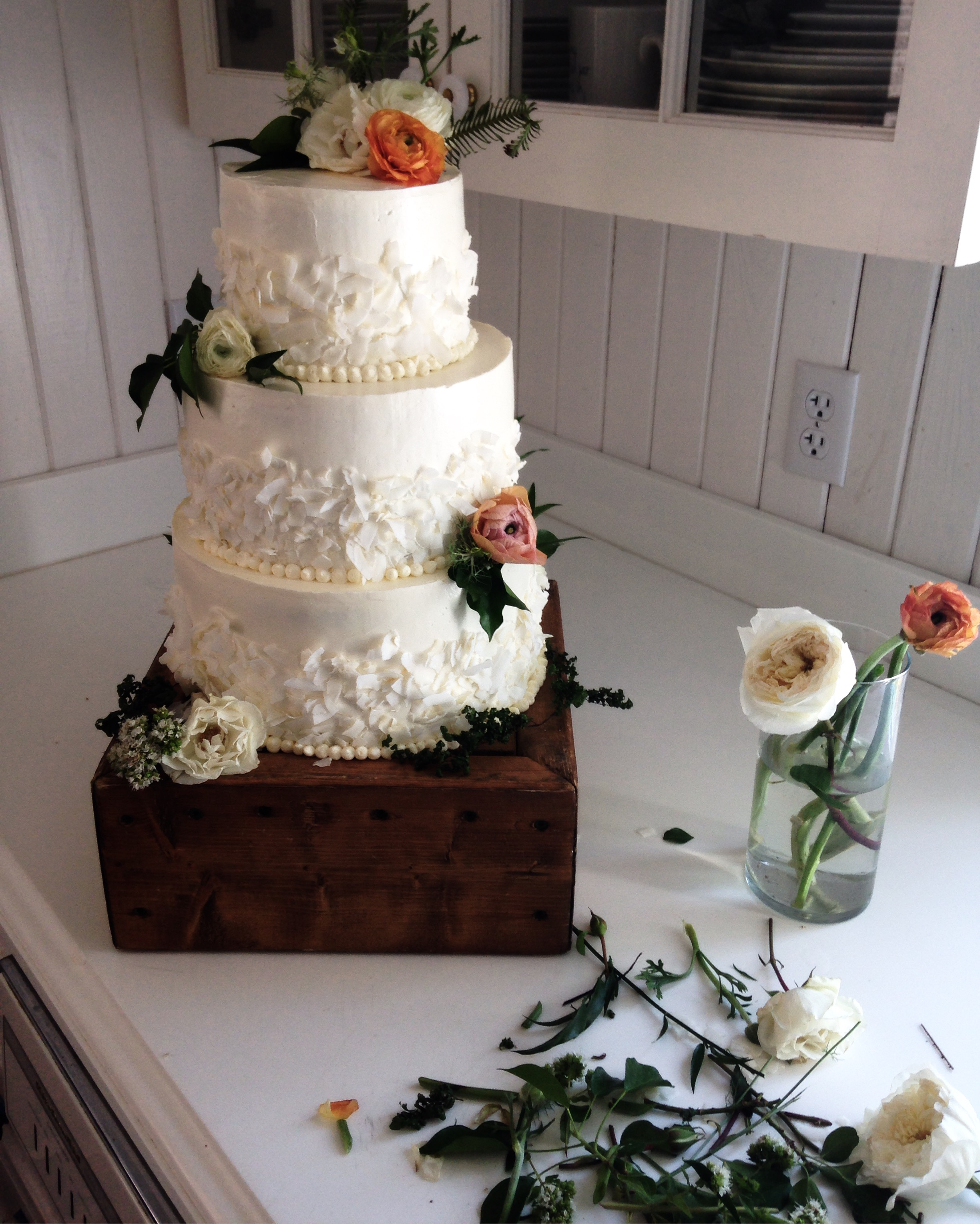 Wedding cake decorated with fresh flowers