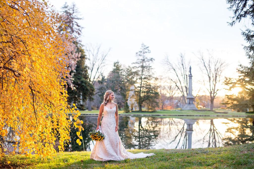 Corey and Alex Larrison Wedding Photography Cincinnati bride beside tree and lake