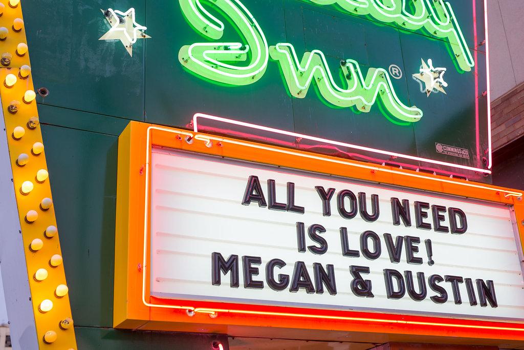 "Corey and Alex Larrison Wedding Photography Cincinnati neon sigh reading ""All You Need Is Love! Megan & Dustin"""