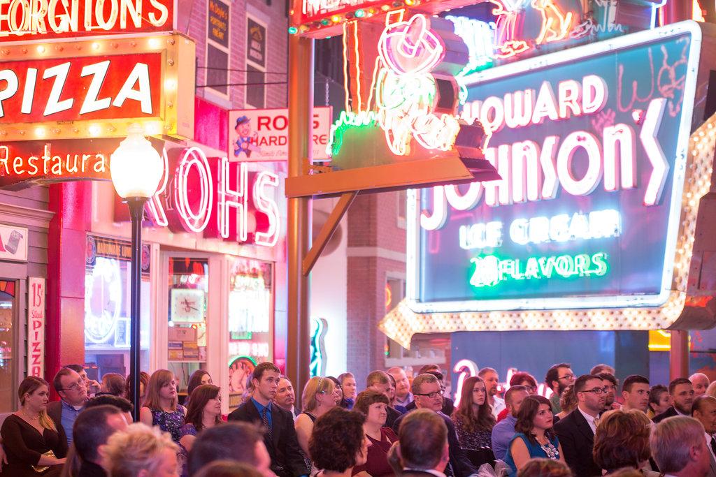 Corey and Alex Larrison Wedding Photography Cincinnati guests under neon signs