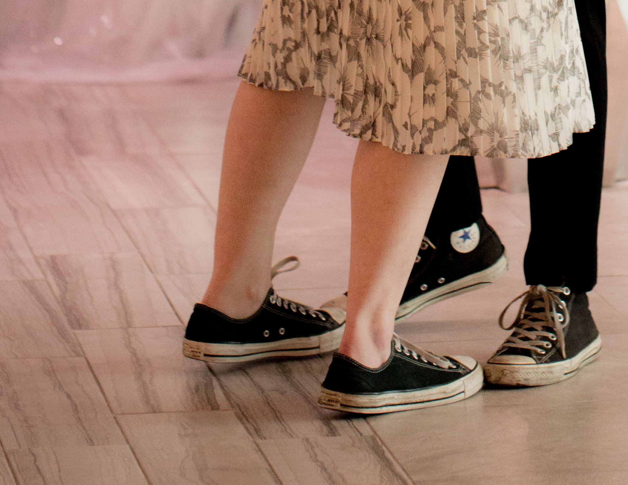 Colleen Stavrakos Wedding Photography close-up on both brides' converse sneakers as they dance