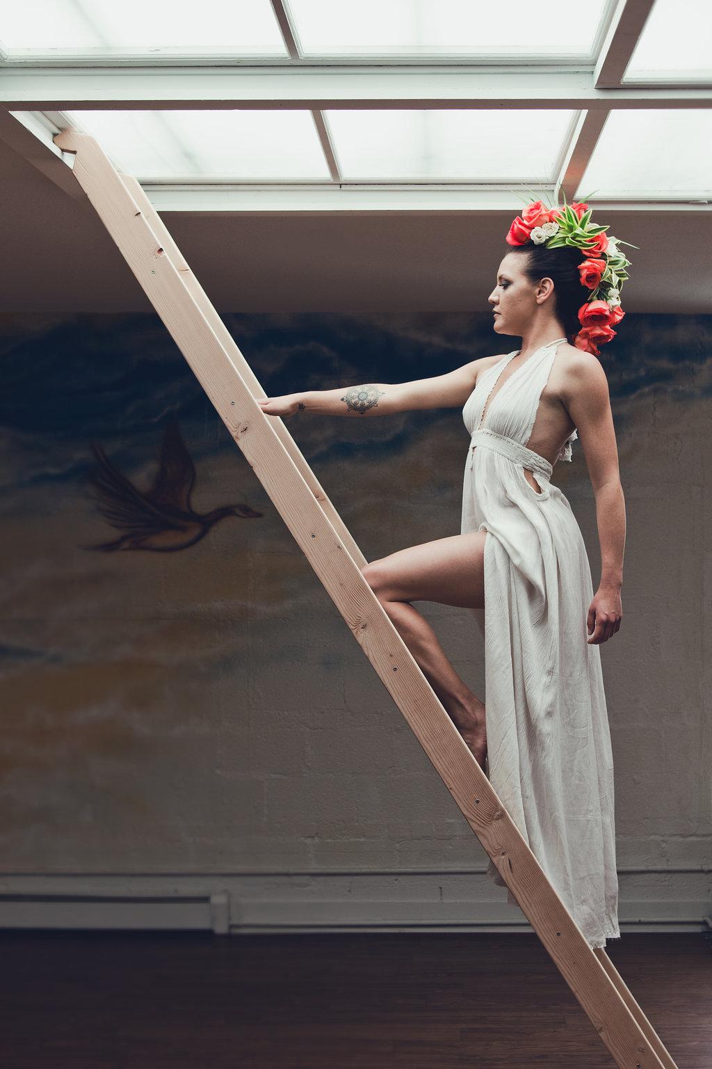 Lisa Rundall Wedding Photography Colorado model climbing ladder
