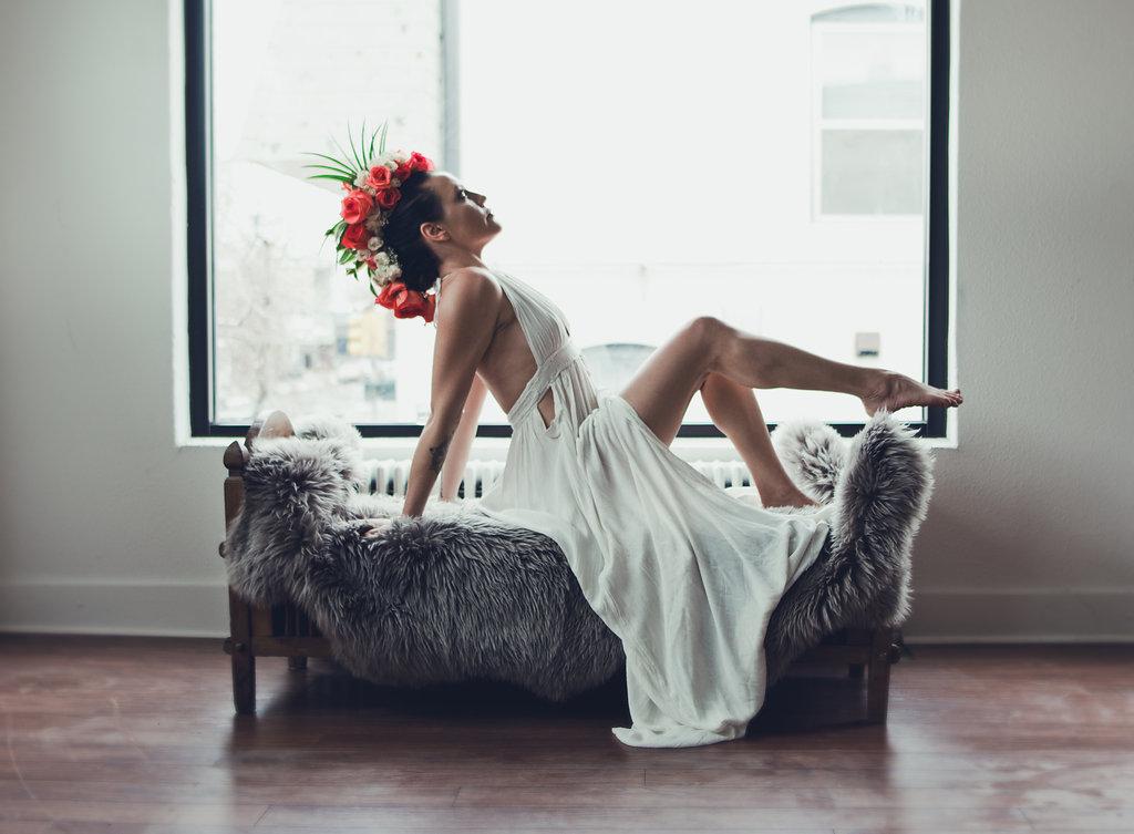 Lisa Rundall Wedding Photography Colorado model posing on fur-blanketed bench