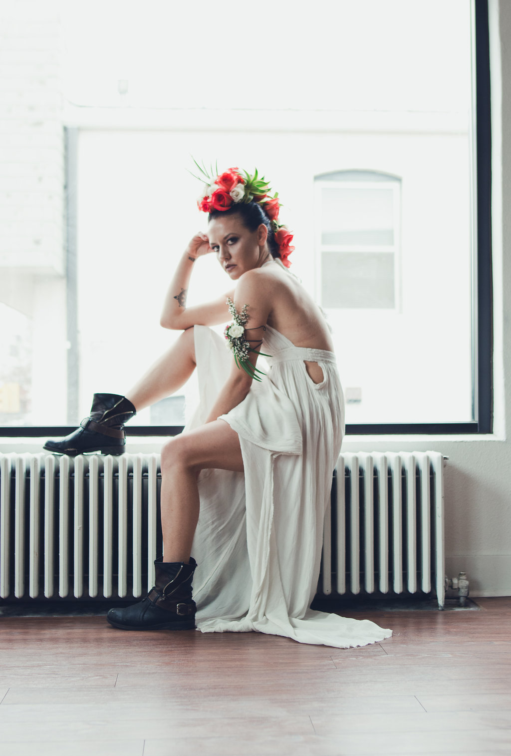 Lisa Rundall Wedding Photography Colorado model sitting with leg up on wall heater