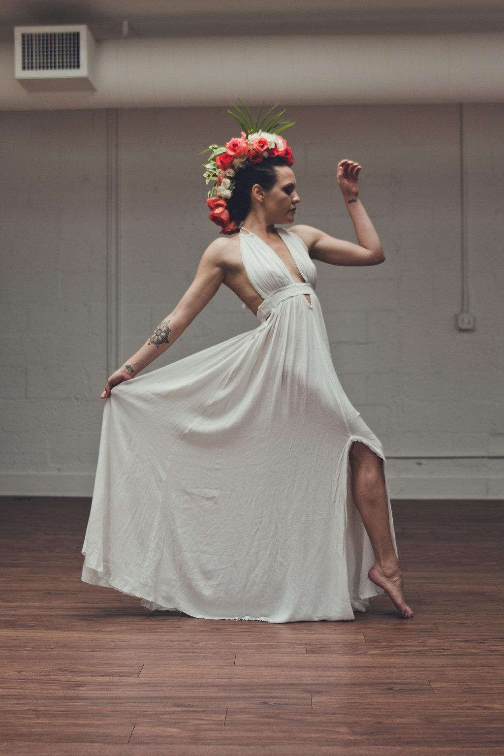 Lisa Rundall Wedding Photography Colorado model with leg forward holding dress skirt
