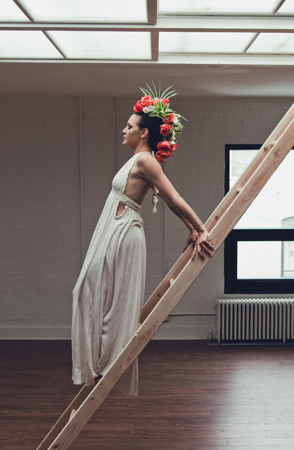 Lisa Rundall Wedding Photography Colorado model standing on ladder
