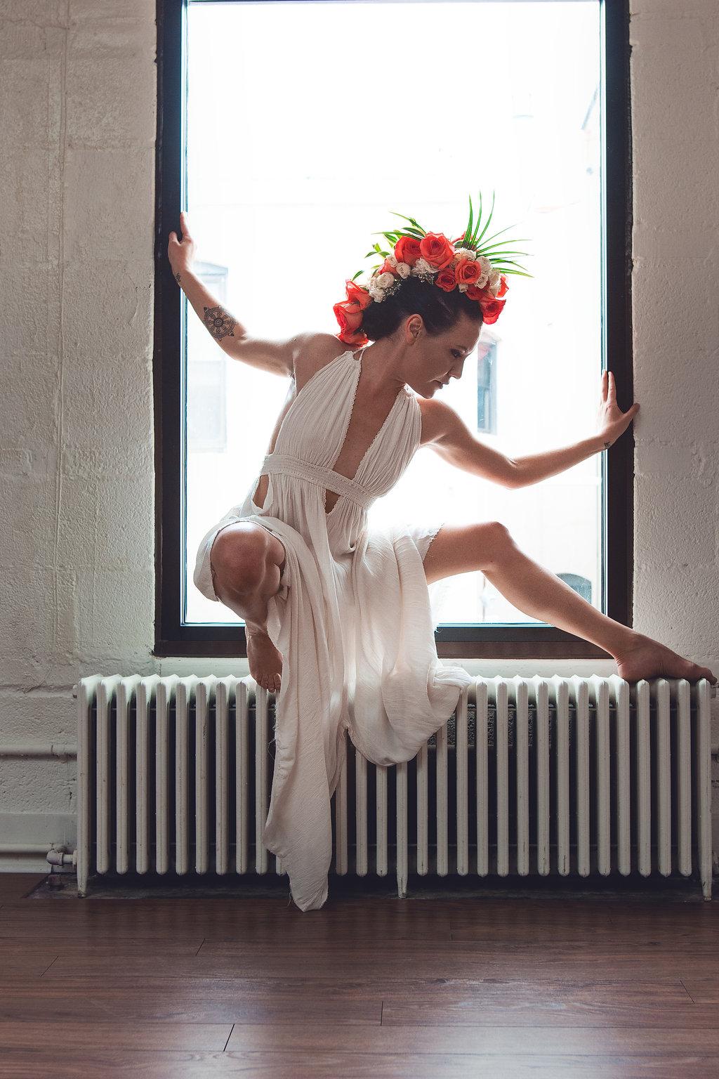 Lisa Rundall Wedding Photography Colorado model posing on wall heater