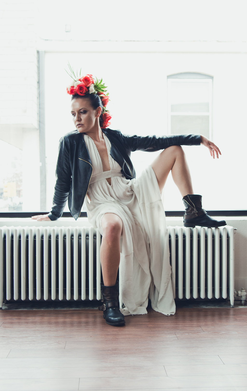 Lisa Rundall Wedding Photography Colorado model sitting with leg propped on wall heater