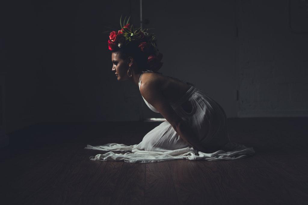 Lisa Rundall Wedding Photography Colorado model sitting forward in dark room