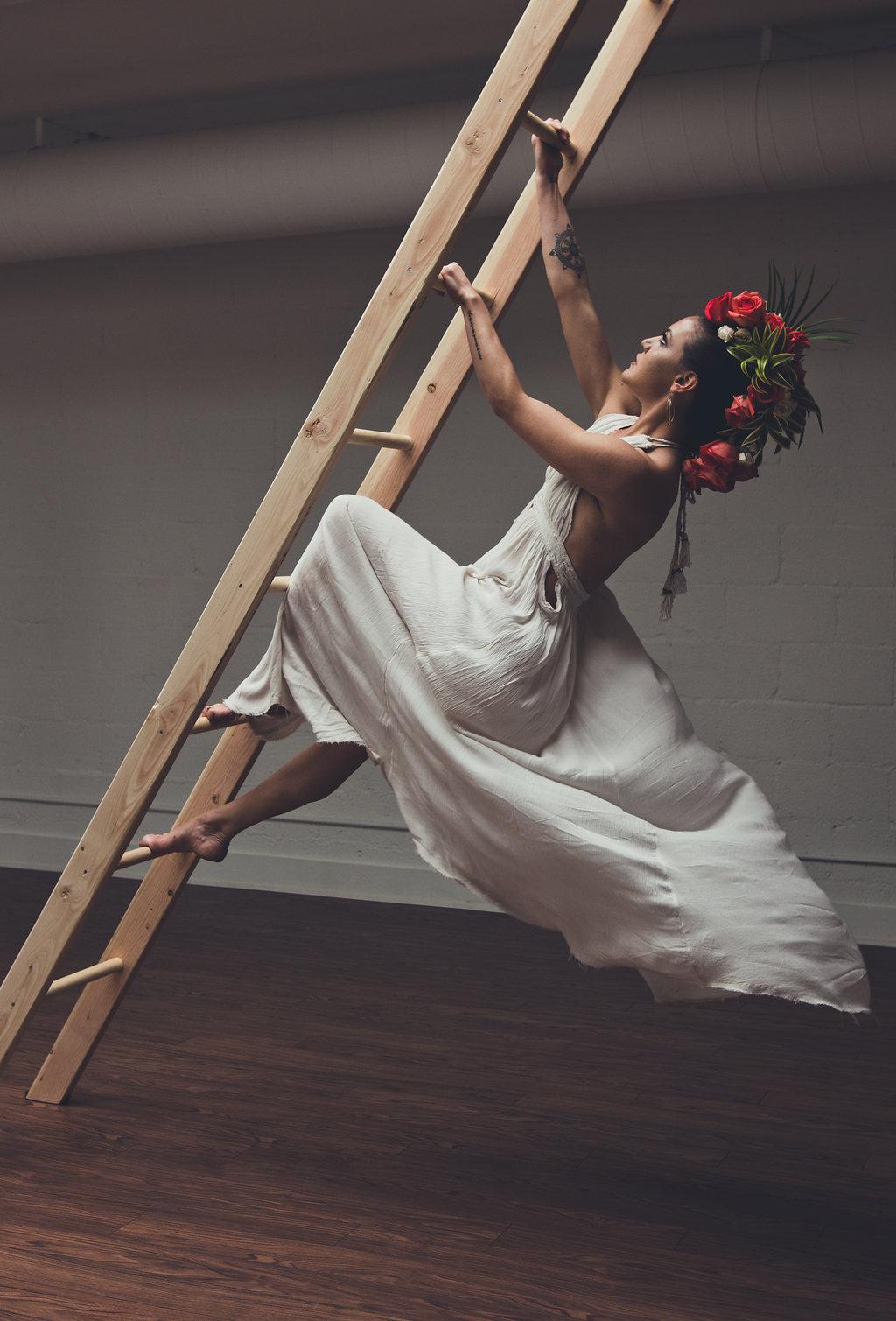 Lisa Rundall Wedding Photography Colorado model climbing back of ladder