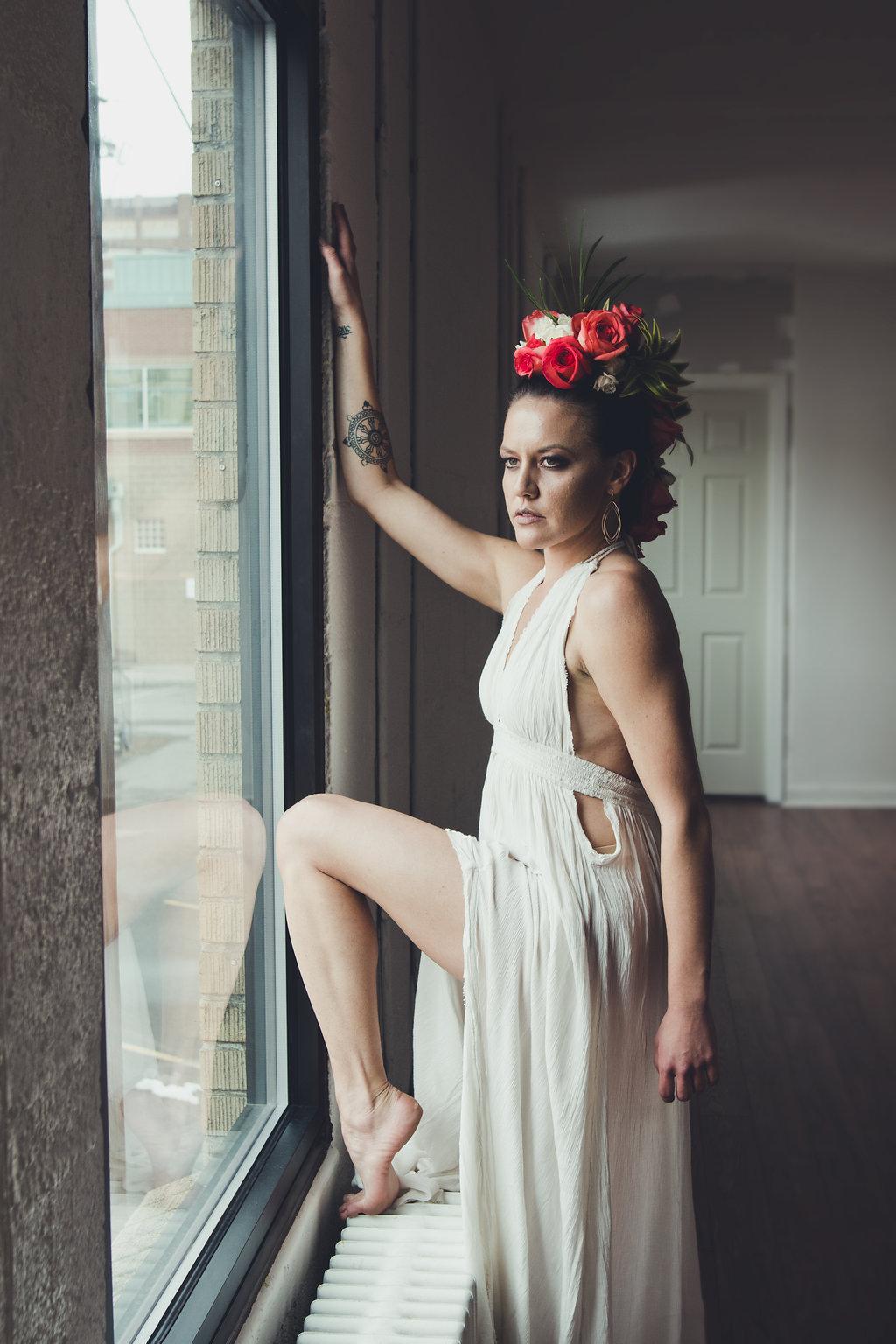 Lisa Rundall Wedding Photography Colorado model with leg on wall heater