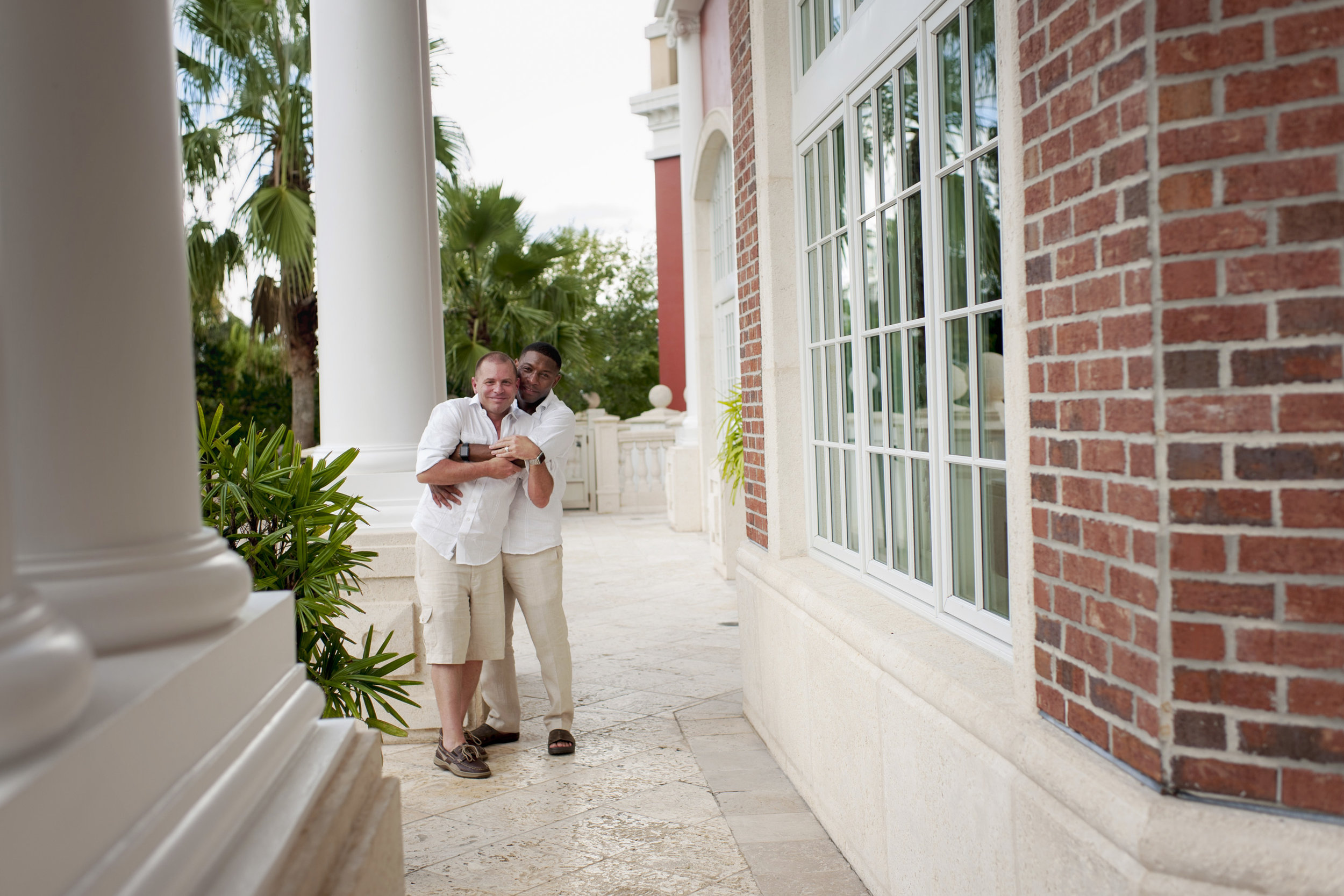 The Canovas Photography grooms hugging on porch