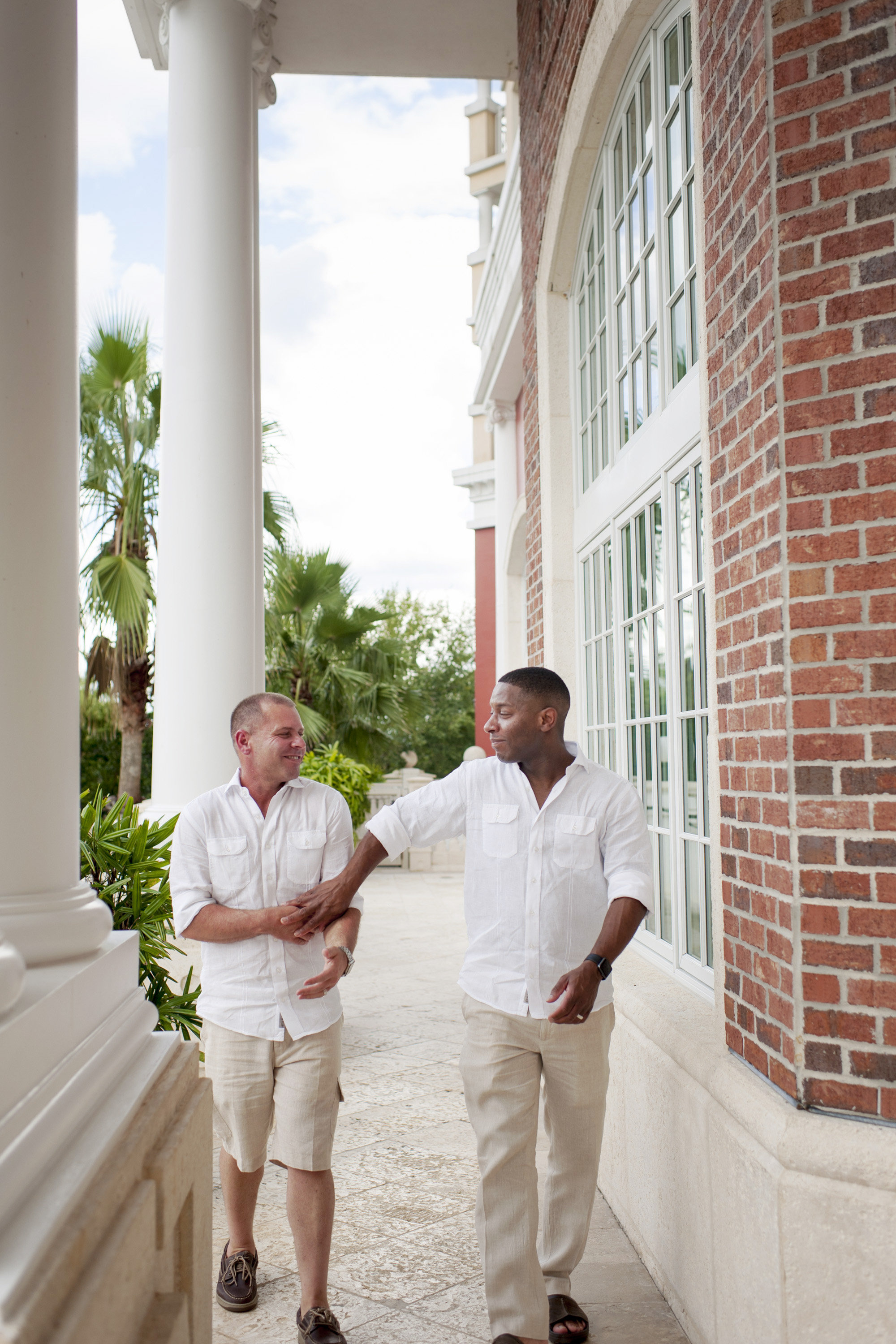 The Canovas Photography grooms walking on porch