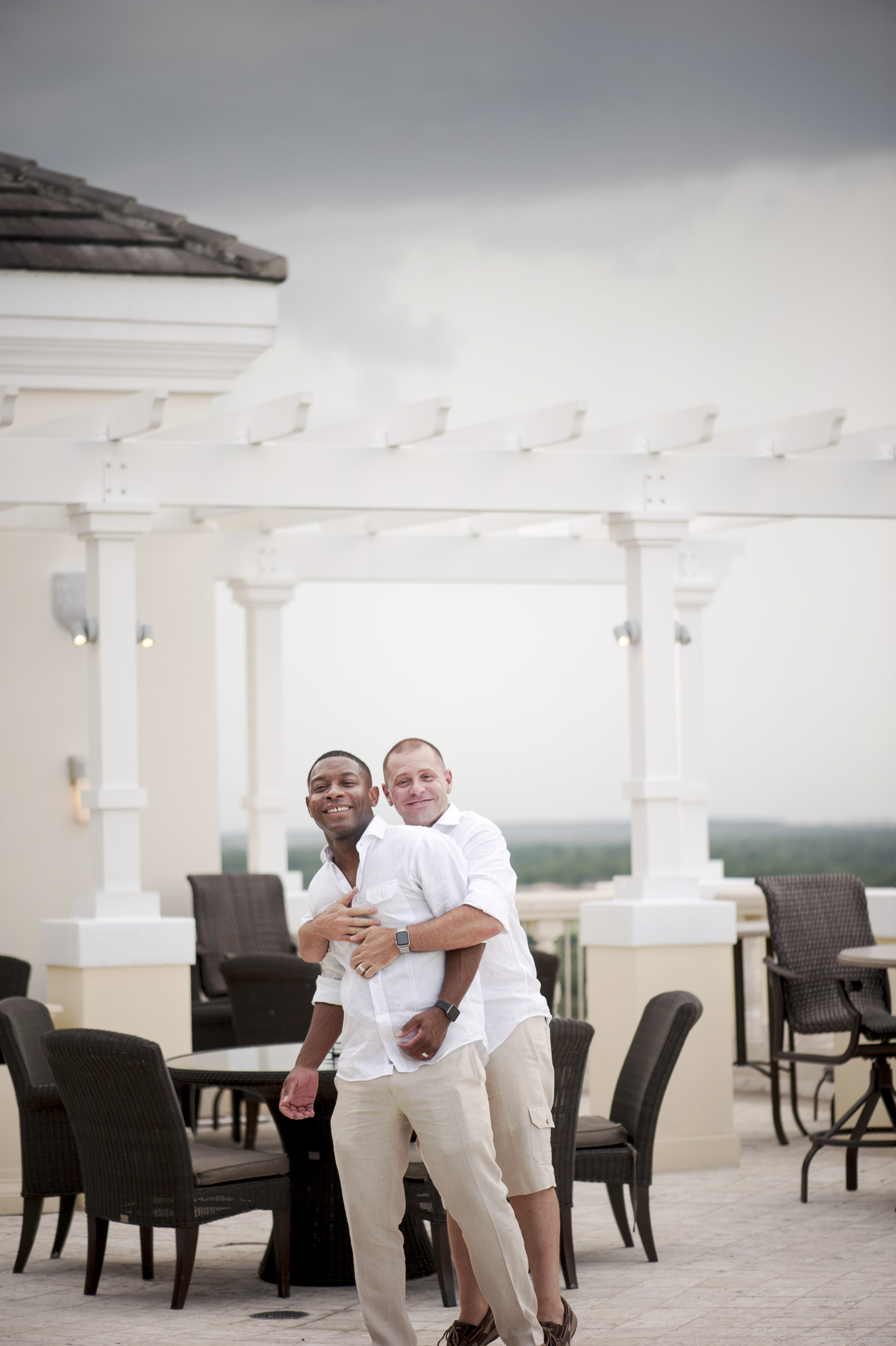 The Canovas Photography hugging in banquet hall