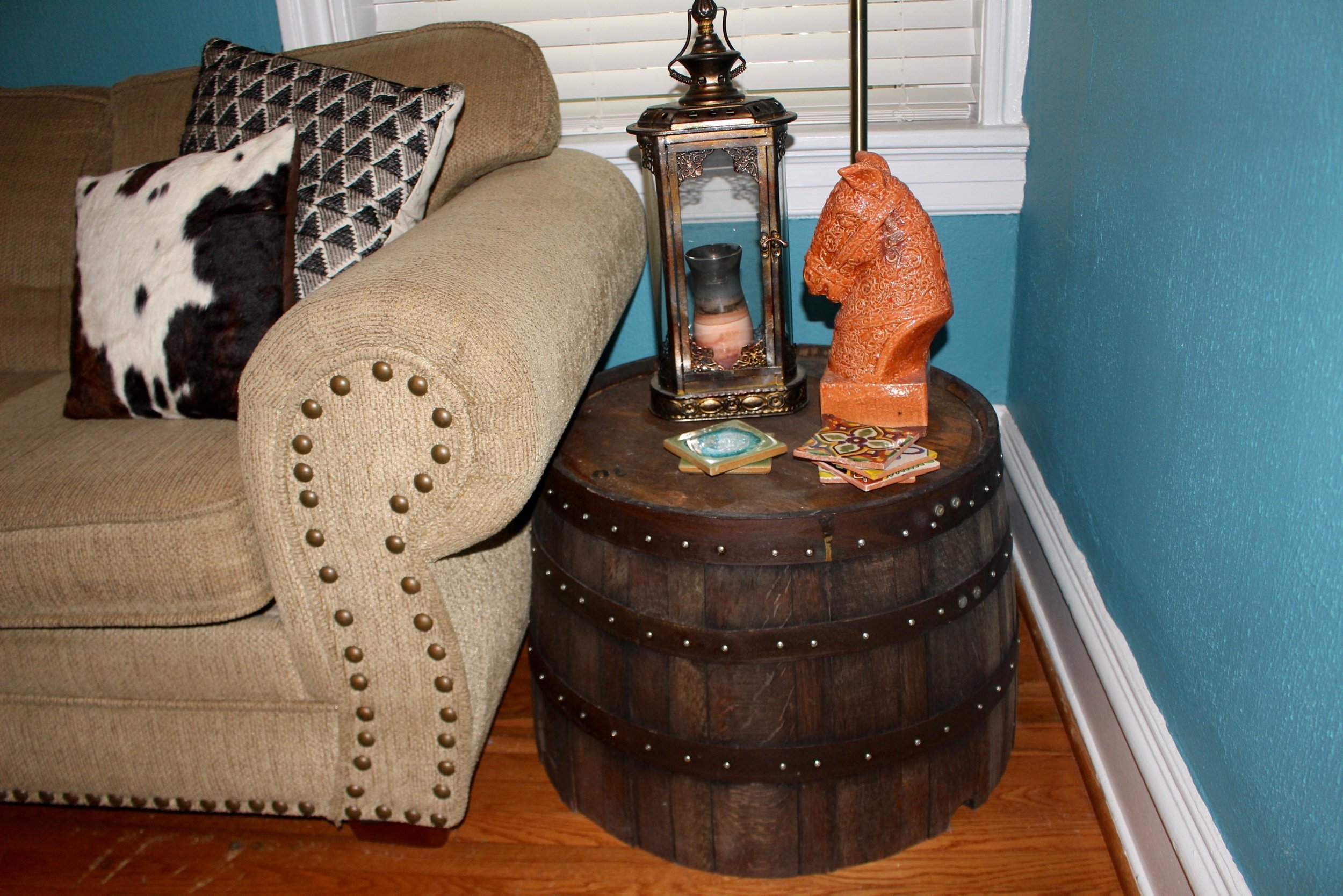 Barrels from the wedding reused as side tables in your home.