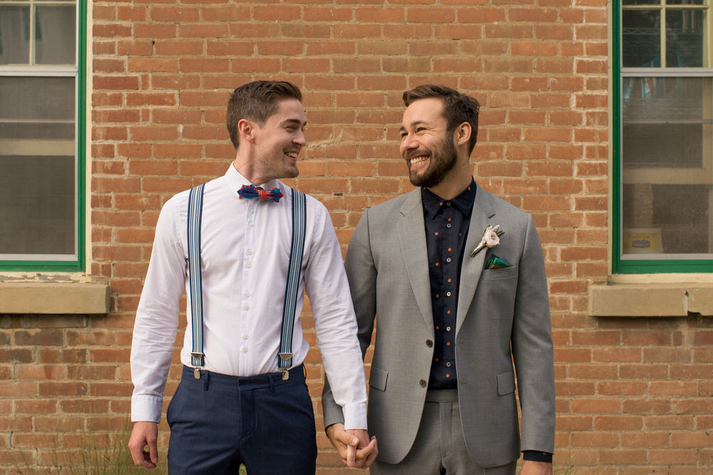 Buffy Goodman Wedding Photography grooms smiling and holding hands