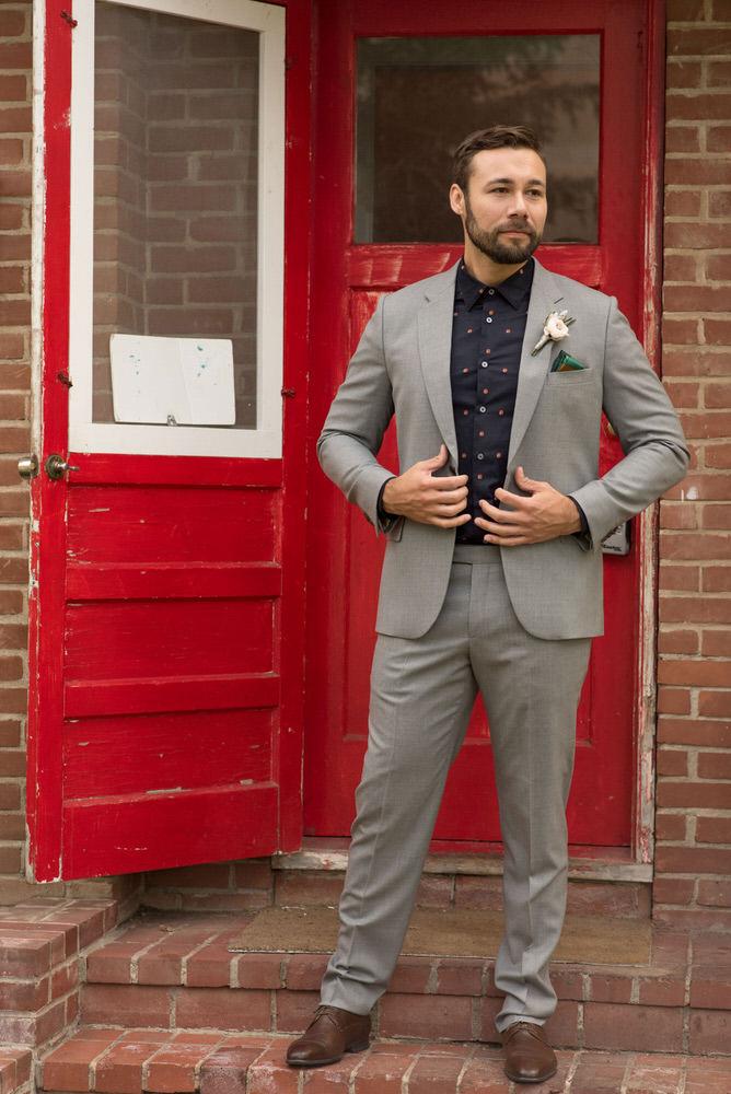 Buffy Goodman Wedding Photography man adjusting jacket