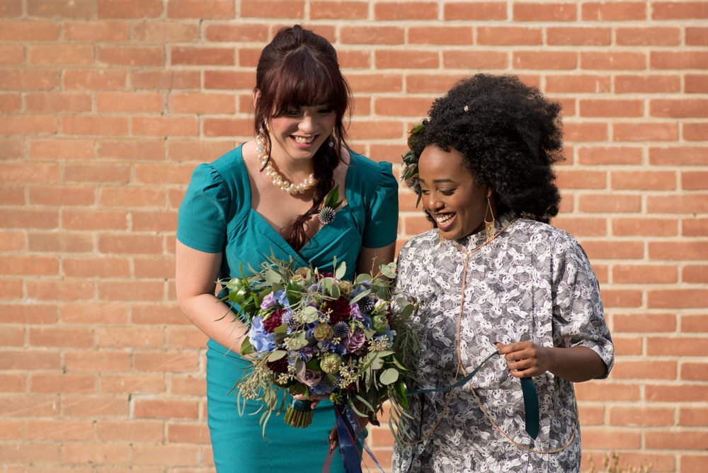 Buffy Goodman Wedding Photography brides admiring bouquet