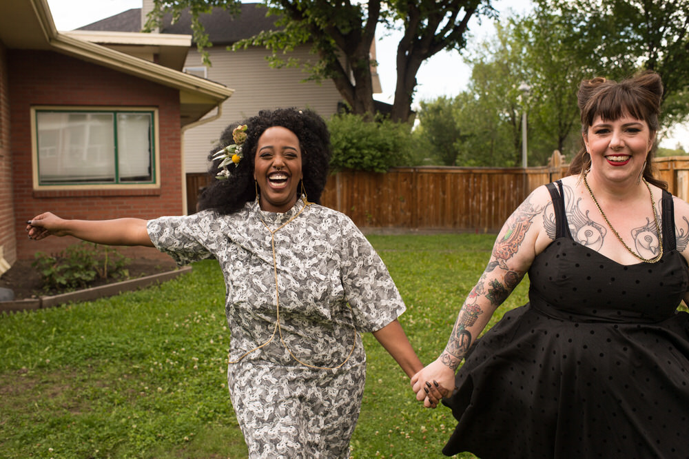 Buffy Goodman Wedding Photography brides running while holding hands