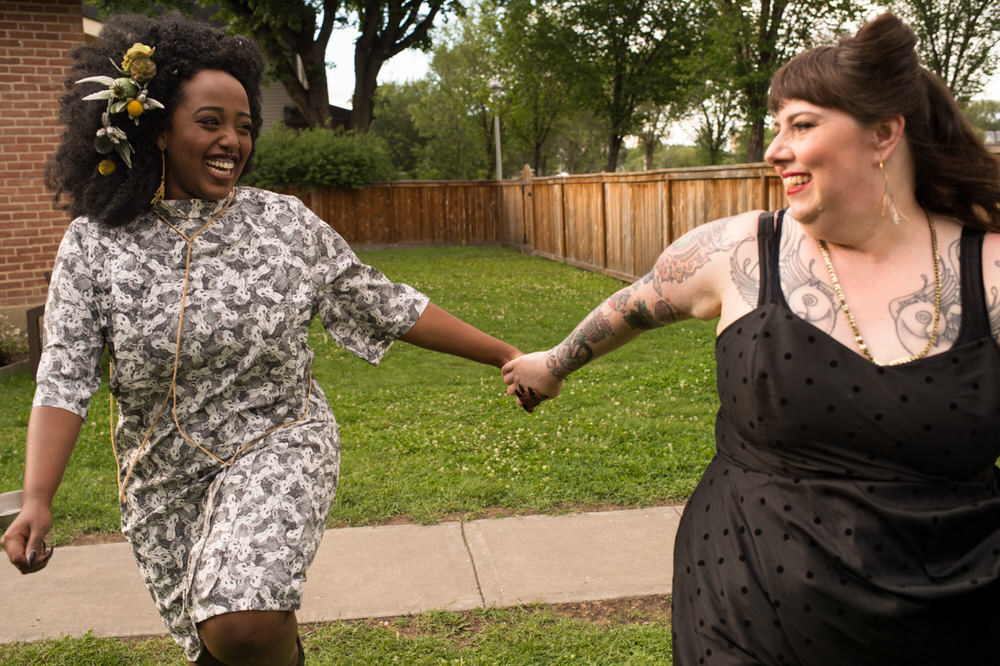 Buffy Goodman Wedding Photography brides in non-traditional wedding dresses holding hands