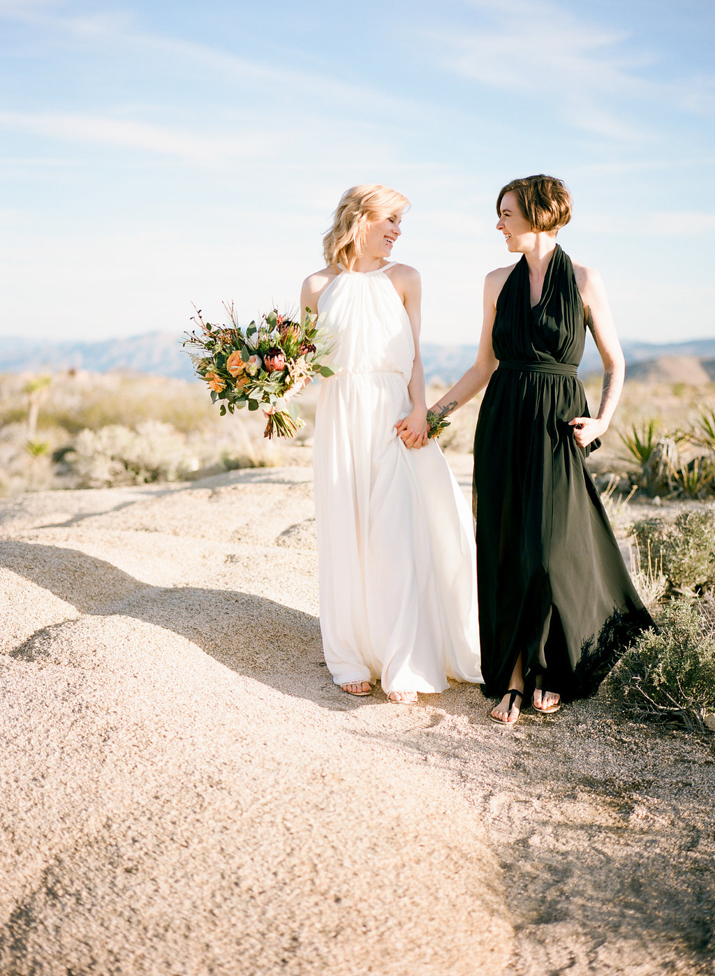 Jessica Schilling Wedding Photography holding hands by sand dune