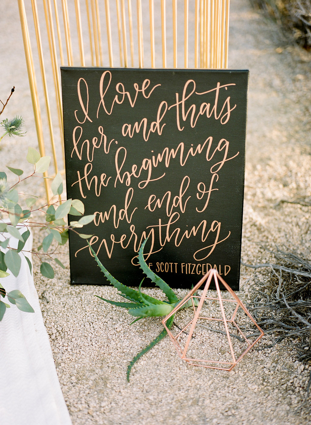 """Sign reading, """"i love her, and that's the beginning and end of everything"""""""