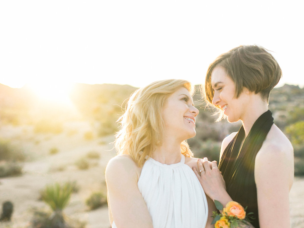 Jessica Schilling Wedding Photography couple smiling at each other with sunny background