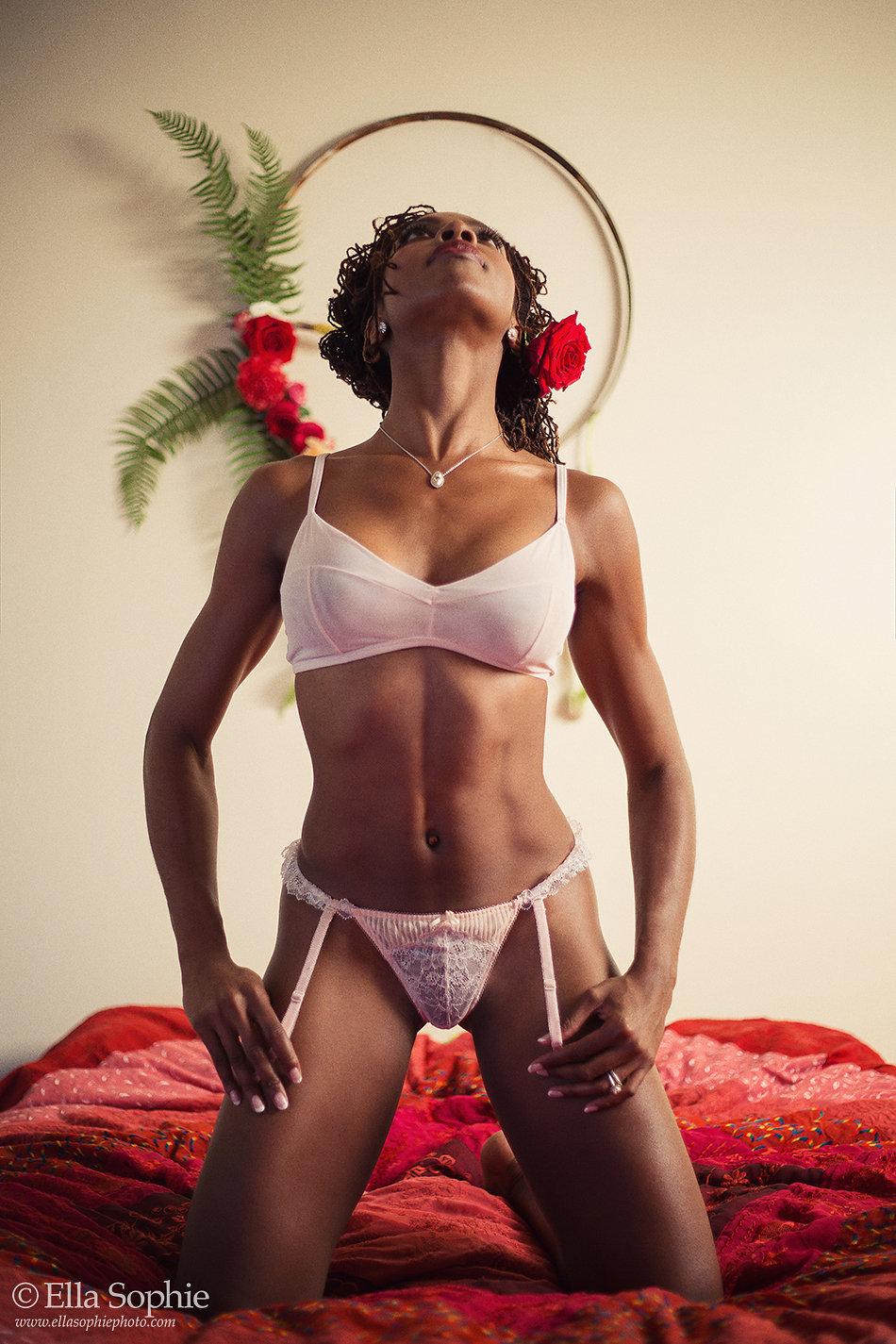 Model posing on her knees in lingerie