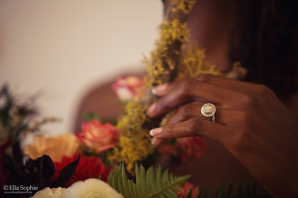 Flowers and hand with diamond ring