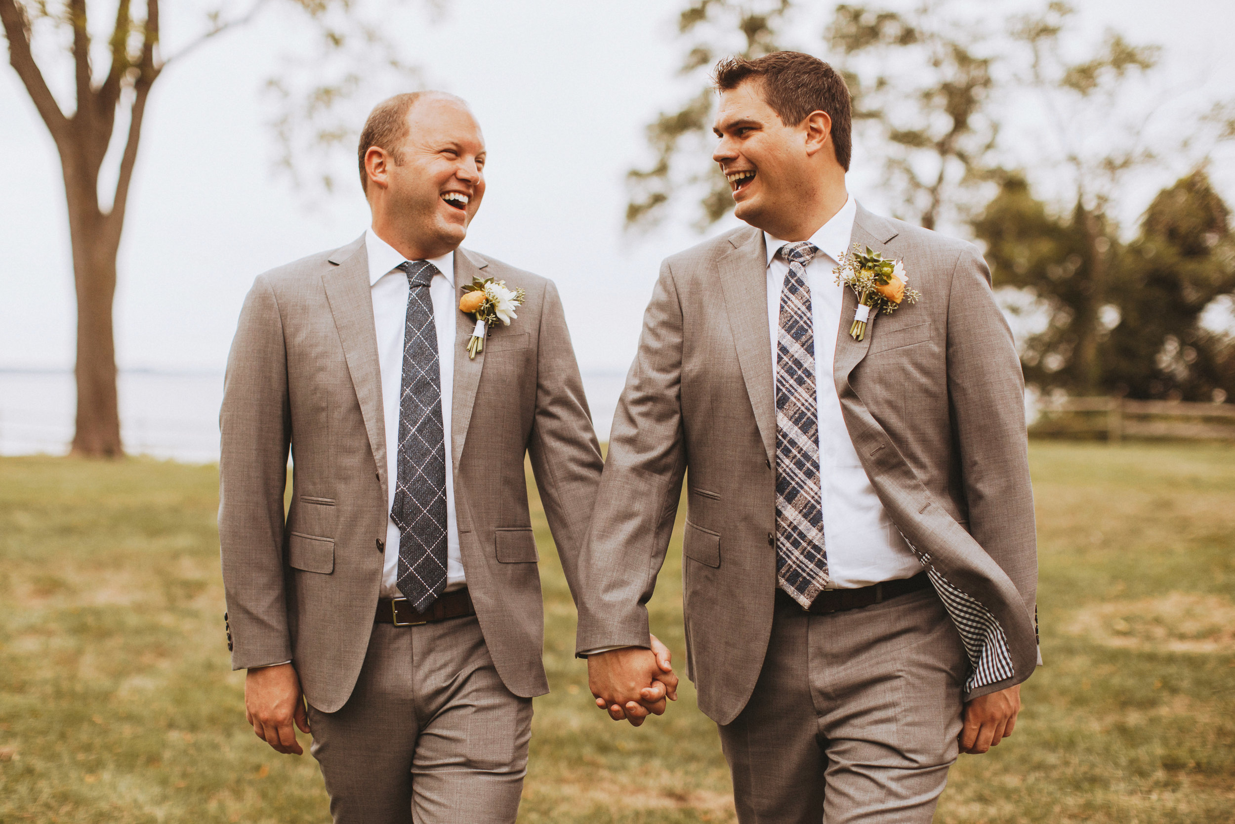 grooms laughing, wearing plaid ties
