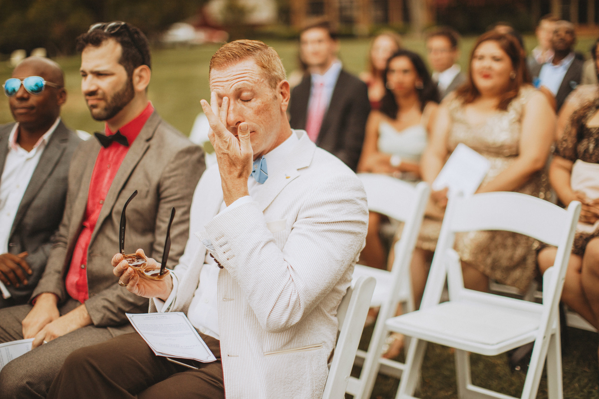 emotional wedding guest during ceremony